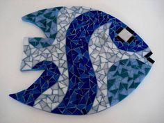 Base MDF, trabalho em mosaico com pastilhas de vidro.  Dimensões: 23cm diâmetro R$ 45,00