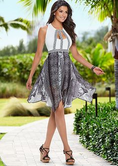 Float straight to the party in this cocktail dress! Venus asymmetrical printed dress with Venus braided detail wedge.