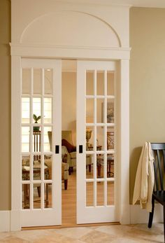 Sliding French and lovely molding to ceiling - would love this in the addition from the kitchen to the office/play room!
