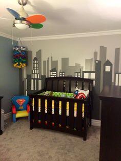 Superhero nursery with city scape mural