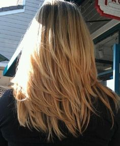 Triangular looking layers hairstyle