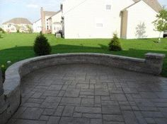 stamped concrete patio with sitting wall