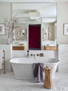 Add beautiful artwork to the bathroom as a unique focal point in a sometimes forgotten space. Best Bathroom Designs, Modern Bathroom Design, Bathroom Interior Design, Home Interior, Modern Design, Interior Colors, White Marble Bathrooms, Large Bathrooms, Diy Bathroom Decor
