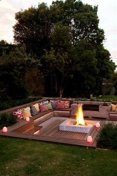 Sunken deck and fire pit: great use for a sloped backyard lot outdoor entertaining bbq fire pit gas