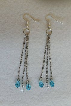 Sterling silver earrings with long chain and glass beads