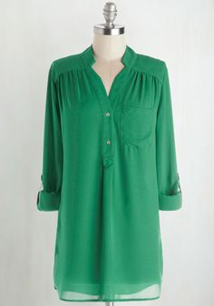 This might be the green top I'm looking for. It's certainly the exact style I had in mind. Pam Breeze-ly Tunic in Green. When you want a work wardrobe thats subtle, stylish, and a little bit romantic, make this breezy, olive green blouse your business! #green #modcloth