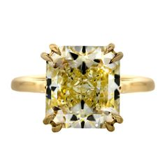 7 Carat Radiant Cut Fancy Yellow Diamond Engagement Ring | From a unique collection of vintage engagement rings at https://www.1stdibs.com/jewelry/rings/engagement-rings/