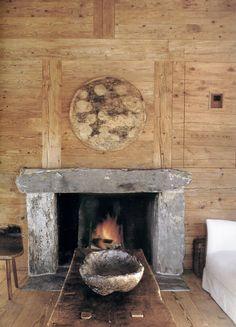 stone hearth / wood wall