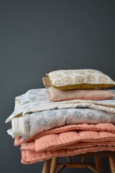 Camomile london's Hand quilted blankets come in bold colours and delicate block prints.