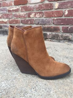 """Step up your bootie game! These tan suede booties from Very Volatile are not only cute, but they are super comfy. Suede leather upper with shapely almond toe Side zipper closure Rubber sole 3-1/2"""" wed"""