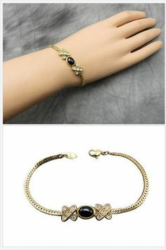 Add a touch of class and glow to your wrist with a lovely vintage Avon bracelet in gold with a dark blue lucite stone centered between rhinestone encrusted X accents.