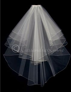 Lovely waves of embroidered edge bridal illusion create this stunning wedding veil. It is waterfall cut, the shortest layer is 35 inches and the longest layer i