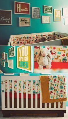 Photographer Ariel Renaes bold nursery for her baby boy. From  Cute crib bedding for a boy giraffe room.