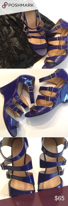 "J. Crew Gwendolyn patent leather wedge sandals J. Crew Gwendolyn patent leather wedge sandals in Deep Violet (really looks more like a cobalt blue). 3 buckle straps and one toe strap. Leather upper; made in Italy. 3.75"" wedge heel. Signs of wear on bottom and slight wear on one strap at buckle; no visible signs of wear and overall excellent condition. J. Crew Shoes Wedges"