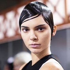 Givenchy, Spring 2017 - While wet hair may be trending, the hairstyle at Givenchy took the shellacked look to an entirely new level with copious amount of gel.