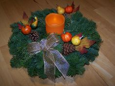 To have a lasting centerpiece for the holidays, use it first as a Thanksgiving table centerpiece.  Simply remove the berries and add your favorite LED candle and some fall decor found at any craft store.