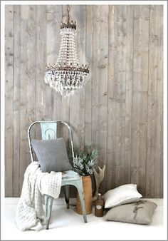 Tolix chair, driftwood wall, chandelier, linen and cable knit pillows. I approve.