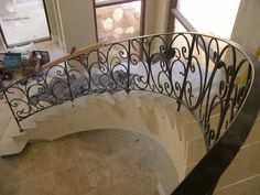 Wrought iron sweeping stair case