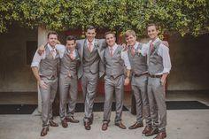 Groom in jacket, groomsmen in vests