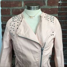 Forever 21 Blush NWT Vegan Leather Jacket Small This item is new with tags and in perfect condition. It has silver spiked studs on wrist and up top near the shoulder. Both zipper pockets are real pockets. The sleeves are 3/4 or if you're tiny like me then they are normal sleeves lol (I'm 5'1) message me with any questions ❤️✌️ Forever 21 Jackets & Coats