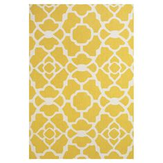 Stylishly anchor your living room or master suite with this delightful hand-hooked wool rug, showcasing an alluring quatrefoil trellis motif in yellow.