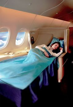 Singapore Airlines Business Class- Yes Please!! If only...we'll be the ones trying to snuggle up in economy :)