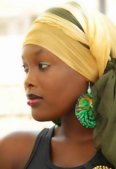 A turbaned head? Quite possibly. Yellow on green #headwrap ★ Maguette Sakho, beauty from Senegal ★
