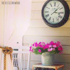 Using an old, galvanized mop bucket as a flower container | The Rustic Boxwood | white, nautical, jute rope, galvanized, metal, country living, farmhouse style, vintage, bar cart, rocking chair