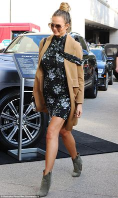 Pretty as a petal: Chrissy, 29, slipped into a delicate shirt dress which perfectly flatte...