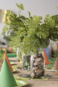 Dinosaur Party Cheap, DIY Dinosaur Birthday Party Table Centerpiece with fake leaves and rocks Dinasour Party, Dinasour Birthday, Dinosaur Birthday Party, 3rd Birthday, Birthday Ideas, Elmo Party, Mickey Party, Pirate Party, Birthday Party Centerpieces