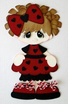 Muñequita con vestido rojo de corazones