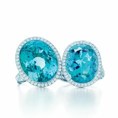 The deep blue-green of tourmaline beckons the eye like a tropical sea. Rings of oval green tourmalines, diamonds and platinum.Tiffany & Co.