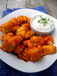 Buffalo Cauliflower Wings with Blue Cheese Yogurt Dip. Think I can get Greg to eat cauliflower?
