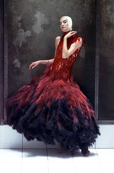 Erin O'Connor in a dress of dyed ostrich feathers and hand-painted microscopic slides, spring/summer 2001