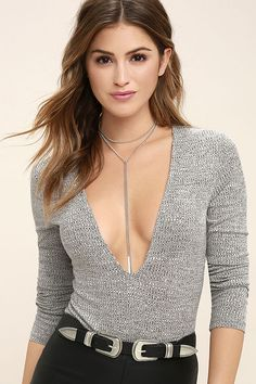 We're anticipating you getting showered with compliments in the Precipitation Grey Long Sleeve Bodysuit! Ribbed knit sweeps across a plunging, V-neckline, long fitted sleeves, and a figure flaunting bodice. Thong bottoms have two snap closures.