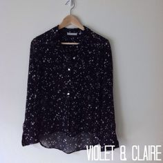 Sheer Navy Button Down with Star Pattern Sheer navy button down blouse with white star pattern. Two pockets on the front. Crepe like material and super lightweight. Worn a few times and in great condition. 100% polyester. Violet & Claire Tops Button Down Shirts