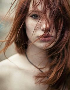 Solene- wild stare, confused, yet awed. Pale, almost deathly so, like she was nothing more than a ghost. Unlike a ghost that was only seen by those it wanted, however, her striking red hair could draw attention in even