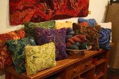 hand hooked pillows by Deanne Fitzpatric.  These are gorgeous. I love the textures.