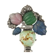 1920's Art Deco Turquoise Sterling Silver Vase Brooch with Carved Flowers | From a unique collection of vintage brooches at https://www.1stdibs.com/jewelry/brooches/brooches/