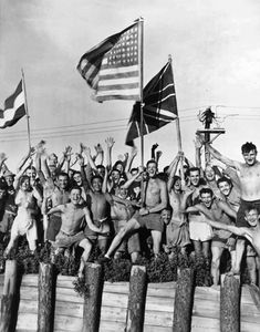 Allied prisoners of war at Aomori camp near Yokohama cheered as US Navy and other Allied personnel arrived to rescue them 29 August 1945.