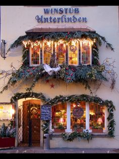 CHRISTMAS IN COLMAR, ALSACE: A WINSTUB , small pub like restaurant featuring local beer and wine, and hearty, simple, local food is decorated for Christmas.