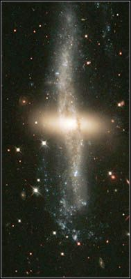"""""""Polar Ring"""" Galaxy NGC 4650A: A disk of red stars ringed by dust, gas and other stars."""