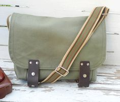 green canvas messenger - love it!Green promote growth and fertility. Carry, wear or place green gemstones around your home or office to promote balance, change and growth.