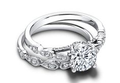 Tear-drop band engagement ring //Courtesy of Jeff Cooper