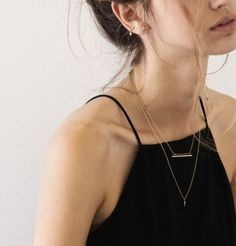 Dainty layered necklaces.