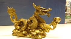 """Hand crafted bronze.  Stands 7"""" tall.  The dragon holds a wish fulfilling ball."""