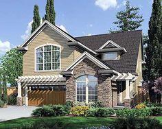Khaki siding, white trim, brown-gray roof, natural stone, warm wood doors