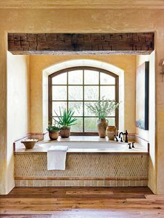 Dress your bath in beige for the ultimate tranquil retreat. These beige bathroom ideas show you how to pair the neutral with warm woods, whites, grays, and other colors. #bathroomideas #bathroomcolorschemes #beigebathrooms #bathroomdecor #remodel #bhg