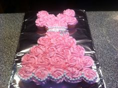 Cupcake Princess cake -oh, oh oh! I could do this without it looking terrible - chocolate cupcakes, purple buttercream.