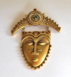 Sale Reduced Vintage Avon 'African Mask' Tribal Brooch. $18.00, via Etsy.